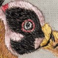 Kopf des gestickten Königsgeiers, Detailaufnahme